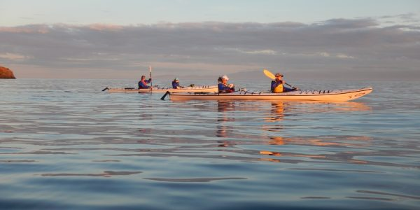 Calm water kayakers crossing channels