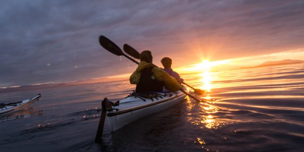 Tandem kayaks with sunset