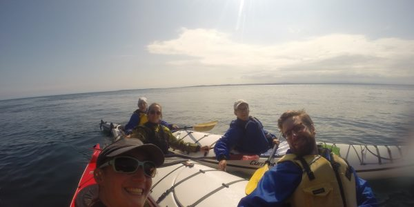 Group of kayakers touring San Juan Island