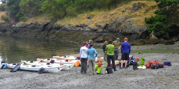 Paddlers loading gear for 3 day kayak tour