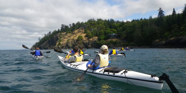 Kayak Tour traveling along San Juan Island shore