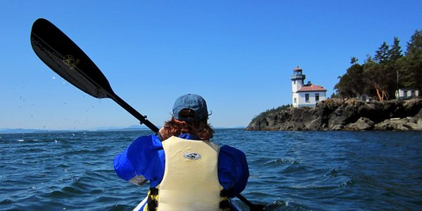 San Juan kayaking past lighthouse
