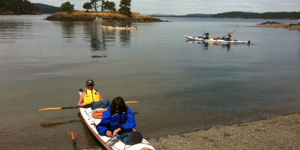 Campers loading kayaks on San Juan Island